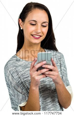 Smiling woman using smartphone on white screen