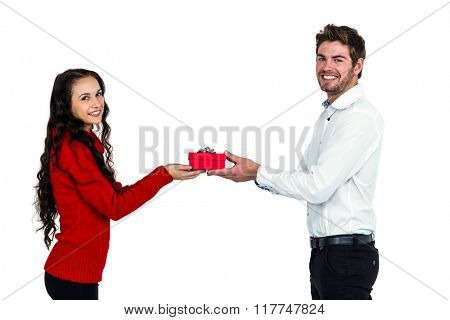 Young couple holding gift box on white screen