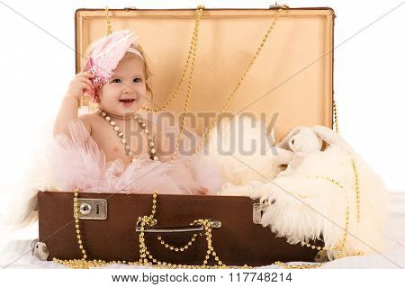 beautiful female baby in the suitcase
