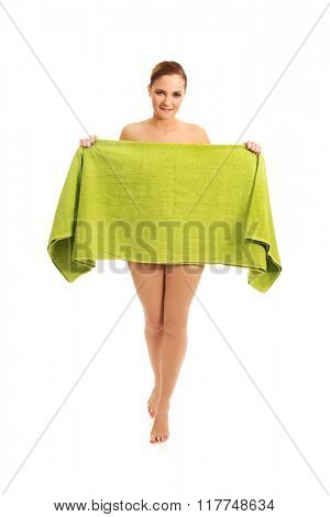 Spa woman covering herself with a towel.