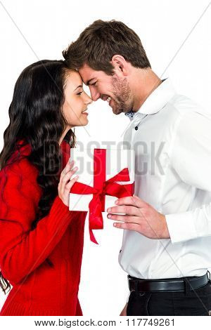 Happy couple holding gift box on white screen