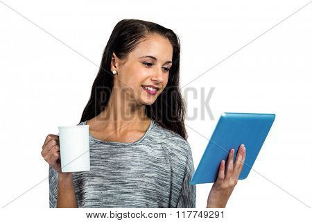 Smiling woman holding cup and tablet on white screen