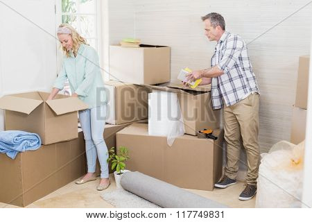 Mature couple moving out at home in the living room