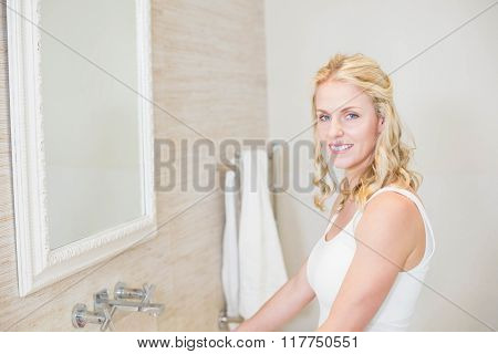 Beautiful woman taking care of herself in the bathroom