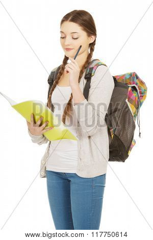 Thoughtful teenager with school backpack.