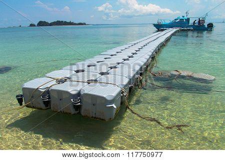 Department of Marine Park Malaysia boat at jetty of Rusukan Besar island near Labuan FT.
