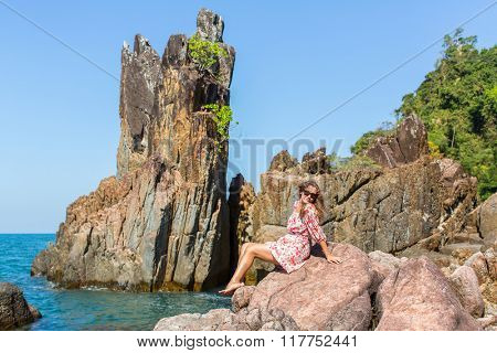 Beautiful woman among the coastal cliffs on Ko Chang island, Thailand.
