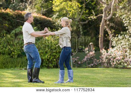 Cute couple dancing in the garden