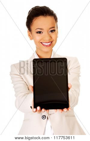 Business woman showing the tablet.