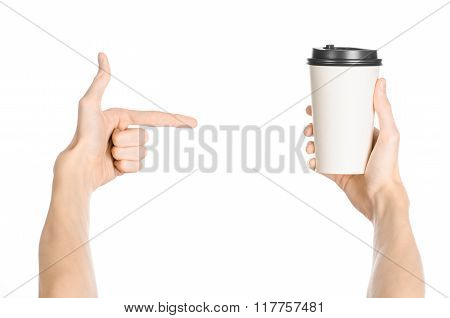 Breakfast And Coffee Theme: Man's Hand Holding White Empty Paper Coffee Cup With A Brown Plastic Cap