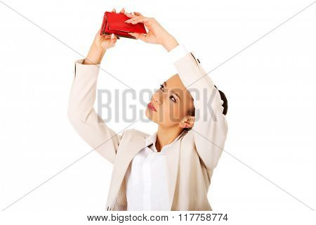 Businesswoman shaking a wallet.