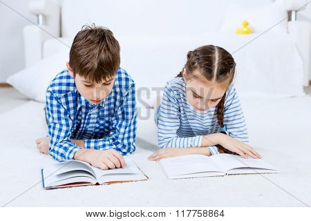Cute kids reading books