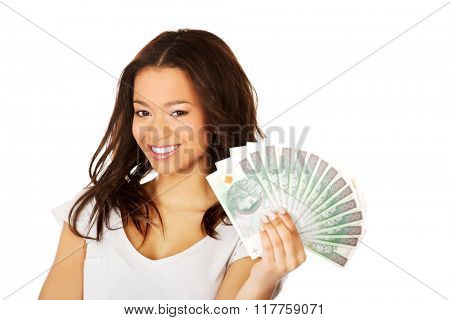 African woman holding polish money.