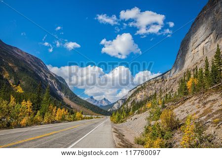 Highway in Banff National Park. Magnificent mountains lit afternoon sun. Canada, Alberta, Rocky Mountains