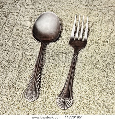 Metal Cutlery On Taupe Fabric Background.toned Image.