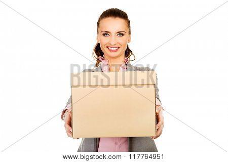 Sad businesswoman carrying box.