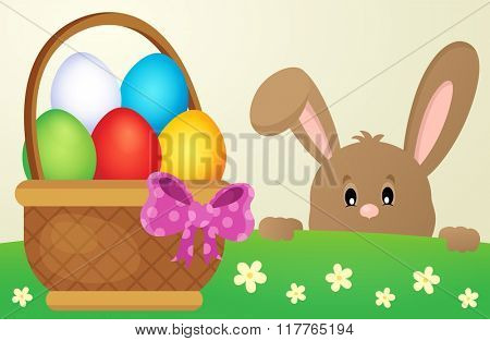 Lurking Easter bunny and egg basket - eps10 vector illustration.