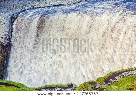 Iceland, Jokulsargljufur National Park. Waterfall Dettifoss - the most powerful in Europe. Roaring mass of muddy water cascading into the abyss