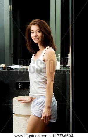 Natural beautiful woman in bathroom.