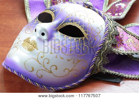 Masquerade mask of grey colour isolated photo