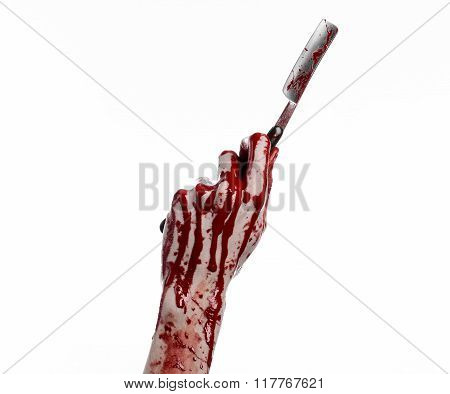 Bloody Halloween Theme: Bloody Hand Holds A Razor Sharp Old With A Dangerous Edge Isolated On White