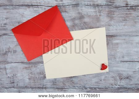 Red envelope and blank paper sheet. Valentine Day background