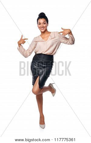 Business woman in full length pointing at herself