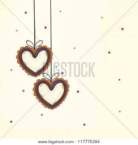 Floral hanging hearts decorated greeting card for Happy Valentine's Day celebration.
