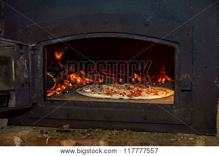 Pizza Cooking In Natural Vintage Stove