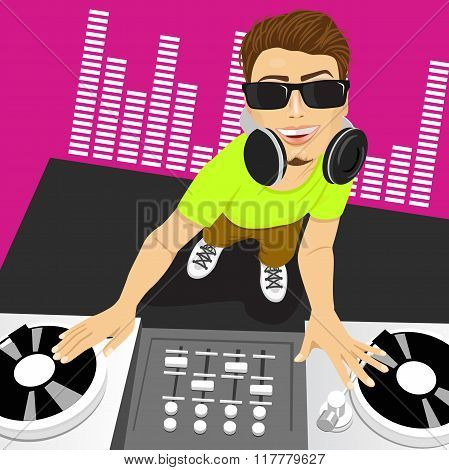 male disc jockey mixing music using his turntables