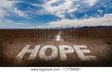 Hope written on desert road