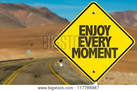 Enjoy Every Moment sign on desert road