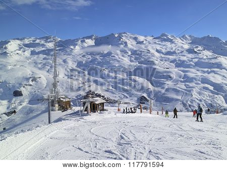 Downhill skiing and snowboarding on slopes in French Alps mountains