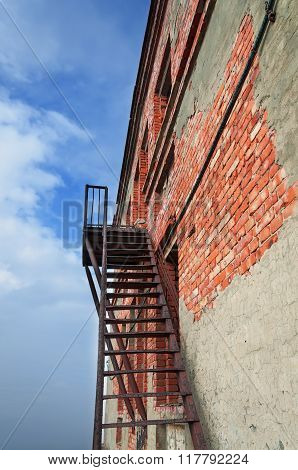 Rusty Fire Escape On The Wall