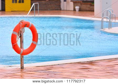 Orange Life Buoy Hanging Near Swimming Pool