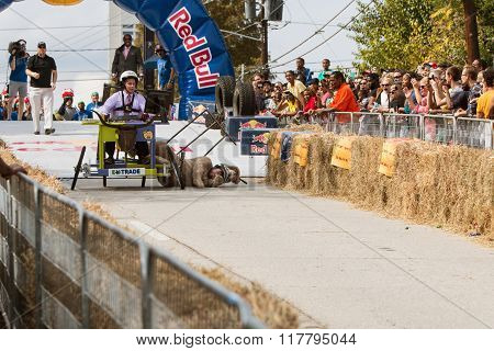 Costumed Competitor Falls Hard From Vehicle In Soap Box Derby
