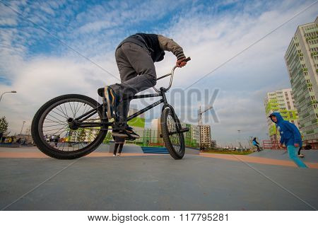 Man on BMX. View from the ground
