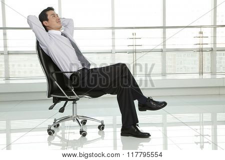 Businessman Relaxing in Chair