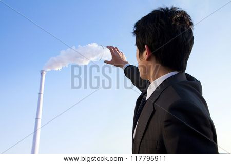 Businessman Collecting Smoke in Beaker