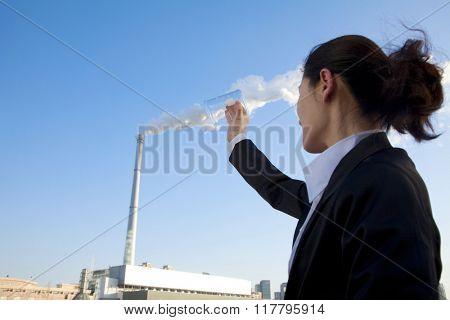 Businesswoman Collecting Smoke in Beaker