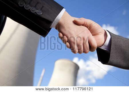 Shaking hands at power plant