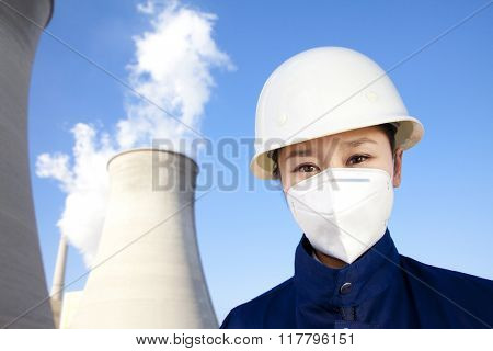 Worker with hardhat and mask at power plant