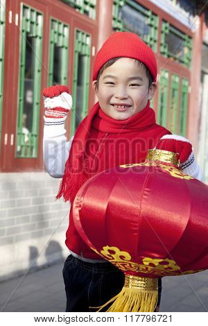 Boy holding red lantern in Courtyard