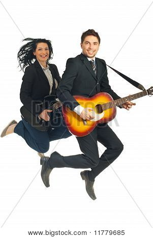 Business People Jumping With Guitars
