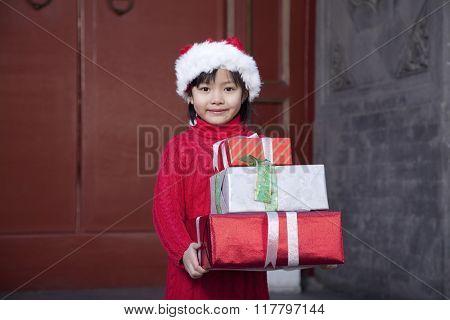 Girl Holding Christmas Gifts