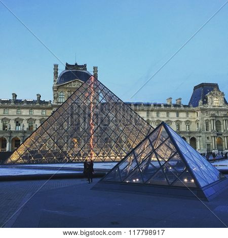 PARIS - OCTOBER 30: Glass Pyramid structures at The Louvre Art Gallery in the early evening on October 30, 2015 in Paris, France.