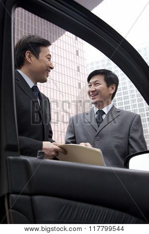 Two businessmen working outside