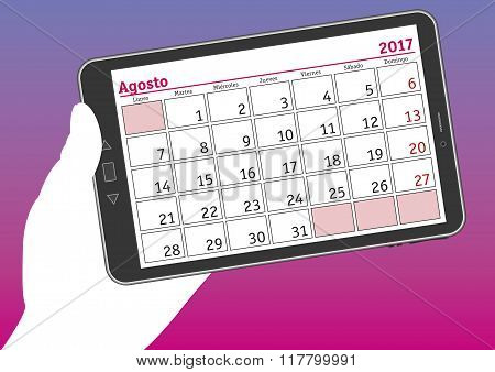 Tablet Pc With A Calendar Sheet Of August 2017 In Spanish