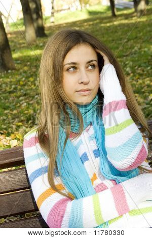 Young woman on a park bench