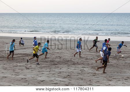 Omani Playing Soccer On The Beach In Muscat